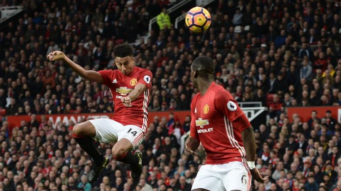Manchester United's English midfielder Jesse Lingard (L) rises to head the ball during the English Premier League football match between Manchester United and Burnley at Old Trafford in Manchester, north west England, on October 29, 2016. / AFP / OLI SCARFF / RESTRICTED TO EDITORIAL USE. No use with unauthorized audio, video, data, fixture lists, club/league logos or 'live' services. Online in-match use limited to 75 images, no video emulation. No use in betting, games or single club/league/player publications. / (Photo credit should read OLI SCARFF/AFP/Getty Images)