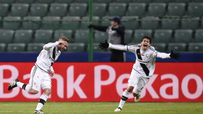 Legia Warsaw's French midfielder Thibault Moulin (L) celebrate scoring with Legia Warsaw's Brazilian midfielder Guilherme during the UEFA Champions League group F football match Legia Warsaw vs Real Madrid CF in Warsaw, Poland on November 2, 2016. / AFP / ODD ANDERSEN (Photo credit should read ODD ANDERSEN/AFP/Getty Images)