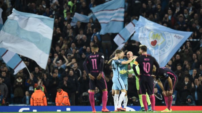 Barcelona's Brazilian striker Neymar (L) and Barcelona's Argentinian striker Lionel Messi (R) react as Manchester City's English defender John Stones, Manchester City's Serbian defender Aleksandar Kolarov and Manchester CIty's Argentinian goalkeeper Willy Caballero celebrate following the UEFA Champions League group C football match between Manchester City and Barcelona at the Etihad Stadium in Manchester, north west England on November 1, 2016. / AFP / OLI SCARFF (Photo credit should read OLI SCARFF/AFP/Getty Images)