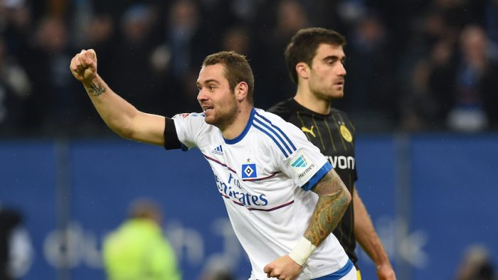 Hamburg's forward Pierre-Michel Lasogga celebrates after the 3-0 own goal scored by Dortmund's defender Mats Hummels during the German first division football Bundesliga match between Hamburg SV and Borussia Dortmund in Hamburg, northern Germany on November 20, 2015. AFP PHOTO / CARMEN JASPERSEN RESTRICTIONS: DURING MATCH TIME: DFL RULES TO LIMIT THE ONLINE USAGE TO 15 PICTURES PER MATCH AND FORBID IMAGE SEQUENCES TO SIMULATE VIDEO. ==RESTRICTED TO EDITORIAL USE == FOR FURTHER QUERIES PLEASE CONTACT THE DFL DIRECTLY AT + 49 69 650050. (Photo credit should read CARMEN JASPERSEN/AFP/Getty Images)