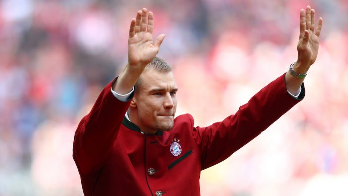 MUNICH, GERMANY - MAY 14: Former Bayern Muenchen player Holger Badstuber waves to supporters prior to the Bundesliga match between FC Bayern Muenchen and Hannover 96 at Allianz Arena on May 14, 2016 in Munich, Germany. (Photo by Dean Mouhtaropoulos/Bongarts/Getty Images)