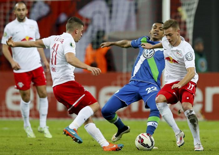 Leipzig's Demme and Kimmich challenge Wolfsburg's Luiz Gustavo during their German soccer cup (DFB Pokal) in Leipzig