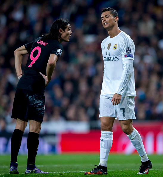 MADRID, SPAIN - NOVEMBER 03: Cristiano Ronaldo (R) of Real Madrid CF reacts as he fail to score as Edinson Cavani (L) of Paris Saint-Germain speaks to him during the UEFA Champions League Group A match between Real Madrid CF and Paris Saint-Germain at Estadio Santiago Bernabeu on November 3, 2015 in Madrid, Spain. (Photo by Gonzalo Arroyo Moreno/Getty Images)