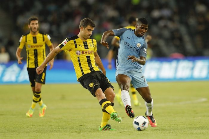 SHENZHEN, CHINA - JULY 28: Kelechi Iheanacho (R) of Manchester City contests the ball against Sokratis Papastathopoulos of Borussia Dortmund during the 2016 International Champions Cup match between Manchester City and Borussia Dortmund at Shenzhen Universiade Stadium on July 28, 2016 in Shenzhen, China. (Photo by Lintao Zhang/Getty Images)