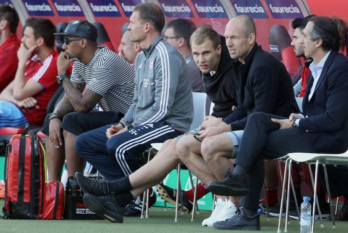 INGOLSTADT, GERMANY - MAY 07: Jerome Boateng (L), Holger Badstuber (4thR) and Arjen Robben (3rdR) of Bayern Muenchen sit next to the bench watching the Bundesliga match between FC Bayern Muenchen and FC Ingolstadt at Audi Sportpark on May 7, 2016 in Ingolstadt, Germany. (Photo by Alexandra Beier/Bongarts/Getty Images)