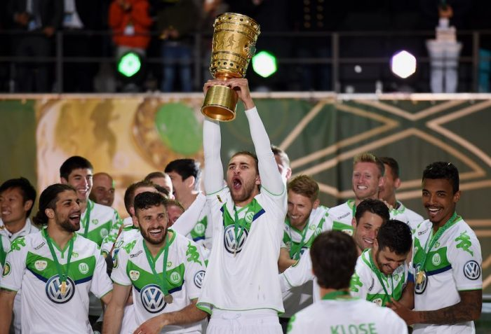 BERLIN, GERMANY - MAY 30: Bas Dost of VfL Wolfsburg celebrates with the trophy after his teams victory in during the DFB Cup Final match between Borussia Dortmund and VfL Wolfsburg at Olympiastadion on May 30, 2015 in Berlin, Germany. (Photo by Matthias Hangst/Bongarts/Getty Images)