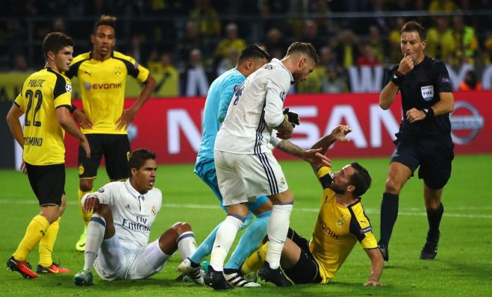 DORTMUND, GERMANY - SEPTEMBER 27: Gonzalo Castro of Borussia Dortmund and Sergio Ramos of Real Madrid clash during the UEFA Champions League Group F match between Borussia Dortmund and Real Madrid CF at Signal Iduna Park on September 27, 2016 in Dortmund, North Rhine-Westphalia. (Photo by Alex Grimm/Bongarts/Getty Images)