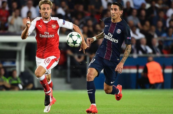 Arsenal's Spanish defender Nacho Monreal (L) vies with Paris Saint-Germain's Argentinian midfielder Angel Di Maria during the UEFA Champions League Group A football match between Paris-Saint-Germain vs Arsenal FC, on September 13, 2016 at the Parc des Princes stadium in Paris. / AFP / MIGUEL MEDINA (Photo credit should read MIGUEL MEDINA/AFP/Getty Images)