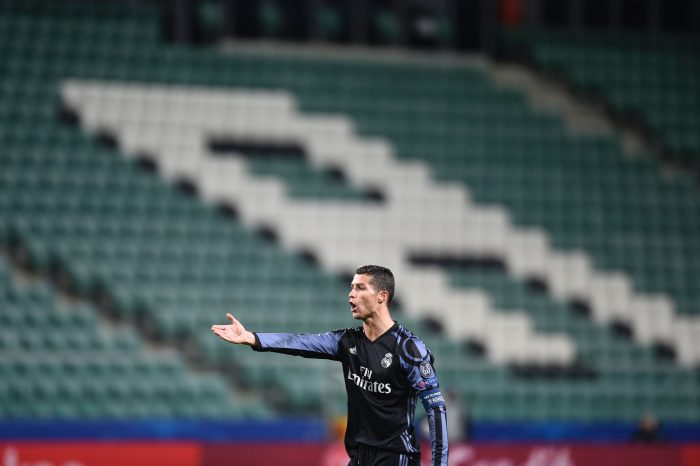 TOPSHOT - Real Madrid's Portuguese forward Cristiano Ronaldo reacts during the UEFA Champions League group F football match Legia Warsaw vs Real Madrid CF in Warsaw, Poland on November 2, 2016. / AFP / ODD ANDERSEN (Photo credit should read ODD ANDERSEN/AFP/Getty Images)
