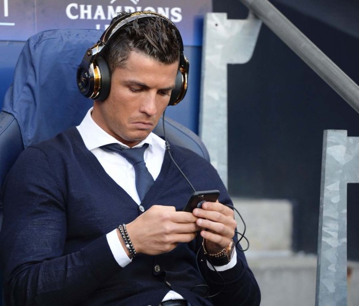 Real Madrid's Portuguese forward Cristiano Ronaldo sits in the dug-out ahead of kick off of the UEFA Champions League semi-final first leg football match between Manchester City and Real Madrid at the Etihad Stadium in Manchester, northwest England, on April 26, 2016. Real Madrid superstar Cristiano Ronaldo was unexpectedly left out of the squad for his side's Champions League semi-final first leg at Manchester City on April 26. Ronaldo was declared fit by head coach Zinedine Zidane on April 25, despite having missed Saturday's 3-2 win at Rayo Vallecano with a thigh strain, and trained with his team-mates on the eve of the game. But he was not even included in the squad to face City, with Spanish winger Lucas Vazquez taking his place in the starting XI at the Etihad Stadium. / AFP / OLI SCARFF (Photo credit should read OLI SCARFF/AFP/Getty Images)
