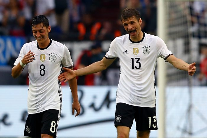 GELSENKIRCHEN, GERMANY - JUNE 04: Thomas Mueller of Germany (R) celebrates the second goal with Mesut Oezil of Germany (L) during the International Friendly match between Germany and Hungary at Veltins-Arena on June 4, 2016 in Gelsenkirchen, Germany. (Photo by Christof Koepsel/Bongarts/Getty Images)