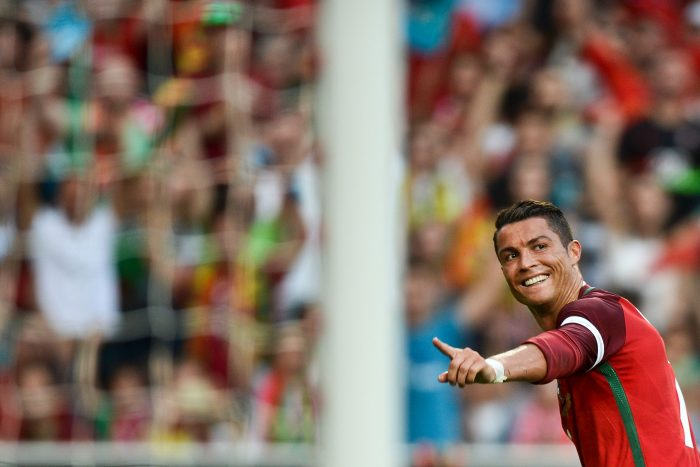 TOPSHOT - Portugal's forward Cristiano Ronaldo celebrates after scored against Estonia during the friendly football match Portugal vs Estonia at Luz stadium in Lisbon on June 8, 2016, in preparation for the upcoming UEFA Euro 2016 Championship. / AFP / PATRICIA DE MELO MOREIRA (Photo credit should read PATRICIA DE MELO MOREIRA/AFP/Getty Images)